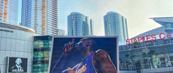 Picture outside the Staples Center of a fan holding a poster of Kobe Bryant